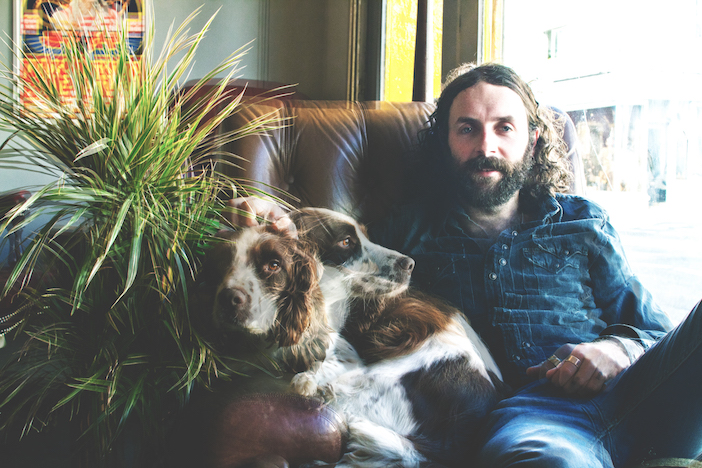Eddie Goatman and a dog in the Nowhere Man cafe
