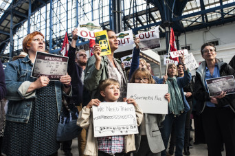 Brighton, East Sussex, 14th June 2016. Commuters hold a protest at Brighton Rail Station after suffering weeks of severe disruption due to staffing problems. Staff have been on strike and calling in sick due to disputes over Southerns proposed move to dri