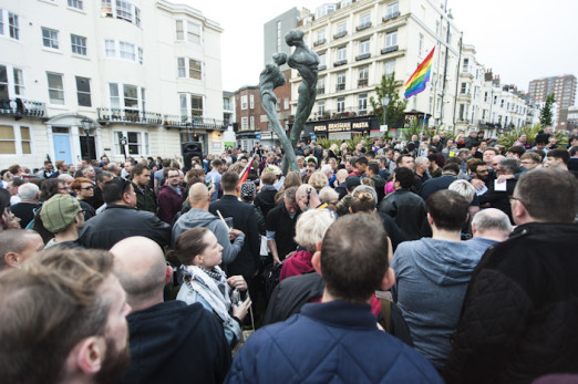 Brighton, East Sussex, 13th June 2016. LGBTQ communities gather for a procession and vigil at Brighton's Aids Memorial Sculpture at New Steine in Kemptown, in memory of and in solidarity with the 49 people killed and others injured at Pulse gay bar in O