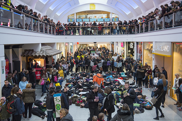 BRIGHTON EXTINCTION REBELLION ACTIVISTS STAGE 'DIE-IN' AT CHURCHILL SQUARE SHOPPING CENTRE